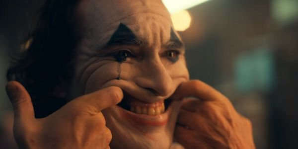 Joker Director Shares BTS Photo of Joaquin Phoenix, Confirms Intended R Rating